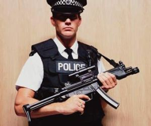 PoliceOfficerHoldingMachineGun
