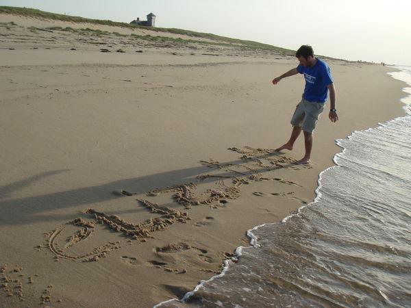 sand guy writing