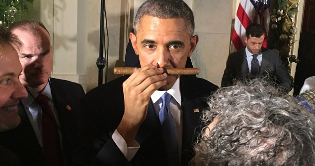 Obama smelling cigar